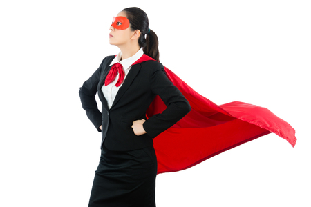 superhero in woman business. confident young businessman wearing a flying cape and mask while standing clean white wall background over blank area with copyspace.