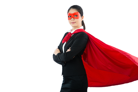 portrait of friendly businesswoman dressed as superhero standing arms crossed in office style isolated on whit copyspace background and wearing red goggles cover eyes. Stock fotó