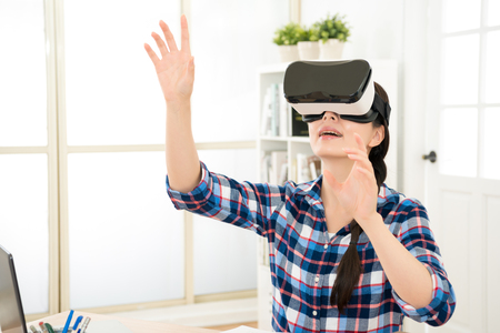 computer simulation: asia beautiful student organize class content by virtual reality in air. person wearing VR headset interact with fictitious image moving with hands raise.
