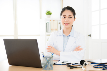 beautiful doctor working at medical office connect relation her treatment patient by internet with computer through online system caring person healthy situation.