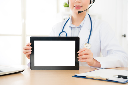 woman with microphone smiling hands holding digital tablet with empty blank screen for copyspace text message, person browsing medicine internet web or connecting to wireless touchscreen pad.