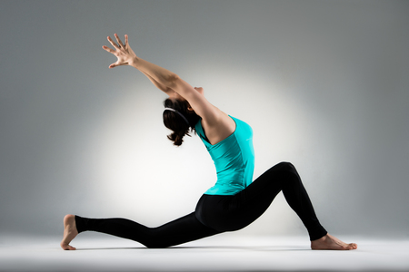 elegant yoga dancer show perfect stretch gymnastics dance posture in gray wall background practice personal performance content in the studio.