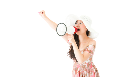 smiling beautiful woman raised hand up to yelling go for travel and using megaphone tool speaker shouting isolated on white background.