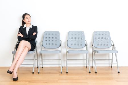 lovely elegant business girl waiting for interview sitting on