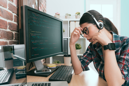 young beautiful operator employee receive customer complaints phone about online website broken and she getting headache painful feeling tired.
