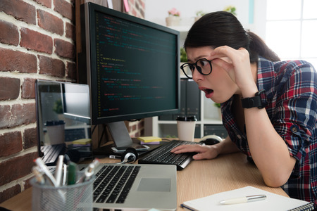 young beauty business women development new online system work in office and finding her mobile computer hacked feeling incredible. Stock Photo