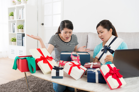 young beautiful girls receive summer sale gift box feeling unhappy. Stock Photo