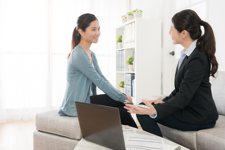 beautiful eelegant business manager lady introduce insuranc plan scheme for young girl and explaining benefit in future. Stock Photo - 89945868