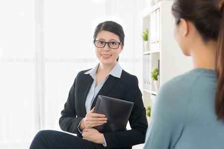professional confident business manager woman holding mobile pad computer looking at camera when she visiting buyers home introduced insurance plan.