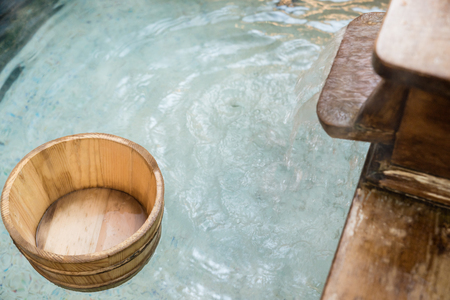 top above view japanese style hot springs space with wooden barrel. nobody no people