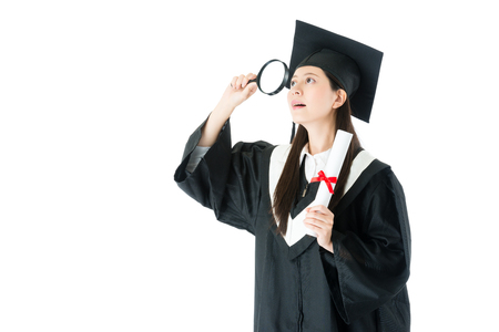 beauty elegant college student woman finished studying getting diploma and wearing graduation clothing using magnifier searching future job isolated on white background.