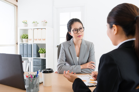beauty attractive business woman listening professional female sales worker explaining new cooperation scheme and introduce deal contract content.