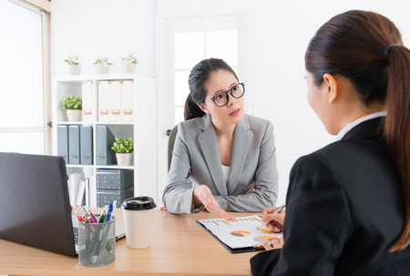 pretty business people women having meeting in office in order to discuss corporation cooperation case.