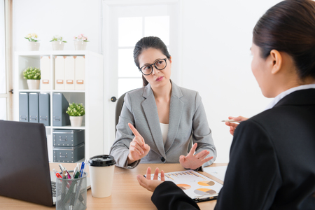 beautiful young business sales woman introducing company new product for partner but female manager feeling unsatisfied and refusing signing deal.