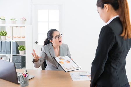 attractive young office boss feeling annoyed blame her staff women because employee not reaching company marketing goal.