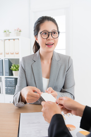 company agent woman exchanging personal business card with client people.