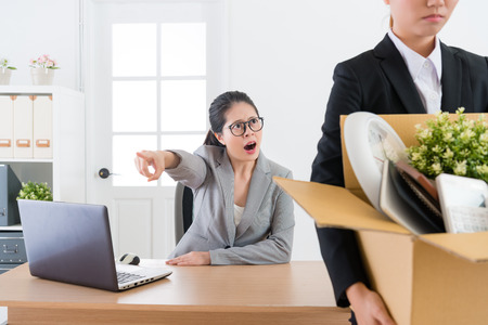 pretty attractive business manager shouting blame employee girl and fired her leaving company.