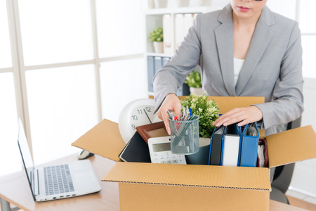 elegant attractive business woman packing personal company belongings when she deciding resignation and changing work in future.