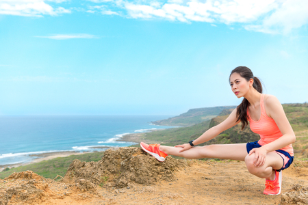 confident beauty girl jogger on mountain viewing landscape and warm up body prepared to run training body workout.