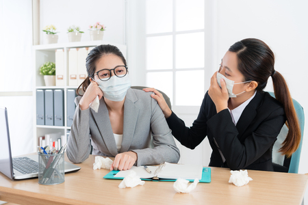 sadness pretty business woman manager feeling uncomfortable and female employee concerned her when she catches cold in flu time.