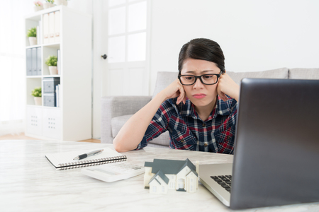 sadness young woman feeling unhappy and confusion during house tax payment time.