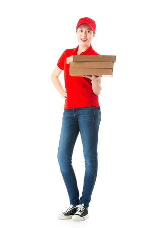 full length photo of confident young woman delivery looking at camera smiling when she shipping pizza meal isolated on white wall background.
