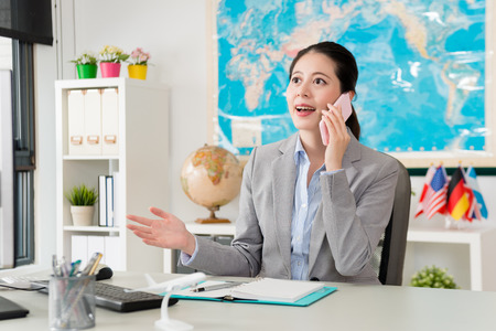 happy beauty lady business manager using mobile cell phone calling for customer discussing travel schedule plan and giving best suggest. Stok Fotoğraf