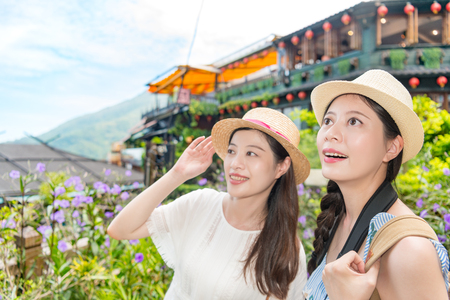 Asian girls happy to visiting the famous place and looking the landmarks view and enjoy the holiday travel in Jiufen of Taipei Taiwan. 写真素材 - 98857038