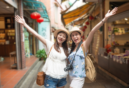 two charming Asian Girl happy enjoy visiting Jiufen town on the mountain of Taiwan. 写真素材 - 98857083