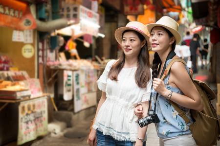 beautiful Asian girls visiting and walking on Jiufen old street pedlar of Taipei Taiwan holiday travel, vendors around. 写真素材 - 98861350