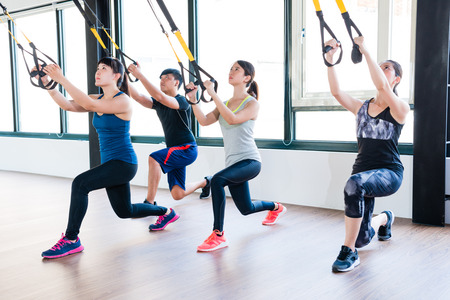 total body resistance exercise trainer training together squat and pull up for whole body muscle workout. Stok Fotoğraf
