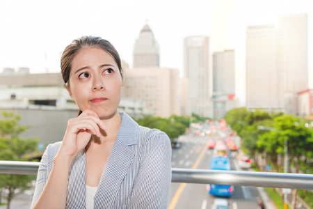 beautiful office woman think of the solution of bad air pollution for peak time traffic.