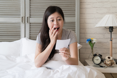 Asian woman popped her eyes out while she found out her numbers are exactly same as the list shown on the TV.