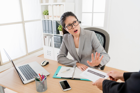Asian female boss reject the request of the resignation from the employee. She is not prepare ready to cope with the question.
