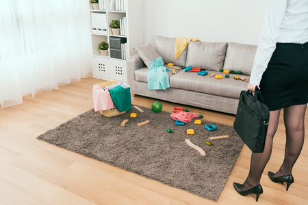business housewife back from work and discover messy living room at home