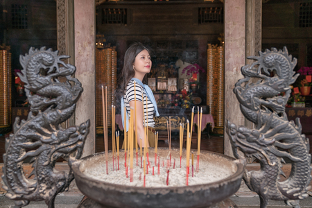 asian lady finishing the ritual in the temple. a holy day 写真素材 - 107255099