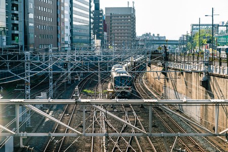 the view of japanese railway with related electronic structures by a background of tall buildings and street. Stock Photo