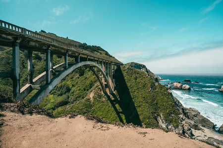 a spectacular landscape combines with bridge train and nature sitting on the coastline to coean.