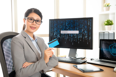 confident female manager works in personal information safety company  showing their new product, credit card which combines online account cyber security concept.
