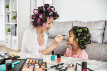 lovely mom help her kid doing makeup for todays performance at school 스톡 콘텐츠