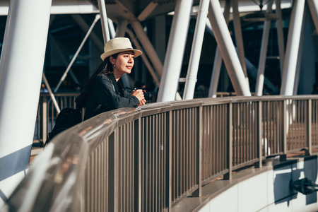 lady photographer with straw hat holding camera. woman tourist enjoy the view. Stock Photo