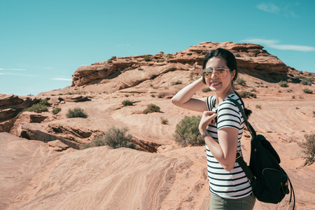 asian lady hiker portrait. Female hiking woman happy and smiling during hike trek on grand canyon national park. Beautiful young Chinese model joyful face camera smiling.