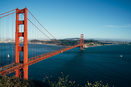 Golden Gate Bridge San Francisco California USA. beautiful urban city view and clean blue sky sea ocean seeing from nature mountain hills. red iron bridge for cars passing.