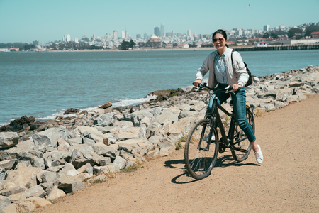 Road bike cyclist woman cycling. Biking Sports fitness athlete riding bicycle sightseeing in sausalito san francisco california usa. Active healthy sports lifestyle travel in america in summer.