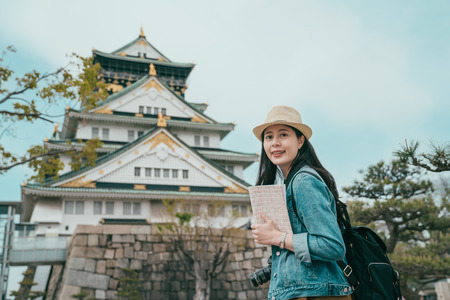 portrait of attractive Japanese tourist woman visiting japan old town and face camera with smiling.