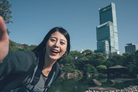 Happy chinese young woman make self portrait smiling face. Stock Photo - 120795360