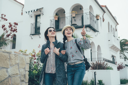 asian women friends on holiday vacation walking in Stearns Wharf in Santa Barbara. Stock Photo