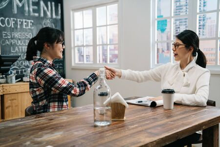 small startup business owner women partners shaking hand deal in bright modern cafe bar. lady hr handshaking female applicant won interview ni coffee shop. friendly successful candidate job seeker Stock fotó