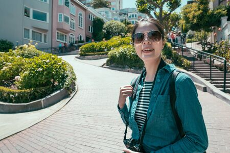 happy tourist woman in sunglasses relax under sunshine at green spring garden.