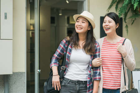Girls shopping and walking in tokyo japan. two asian korean women tourists having fun in old town while buying souvenir. Best female friends sharing happiness lifestyle and friendship concepts